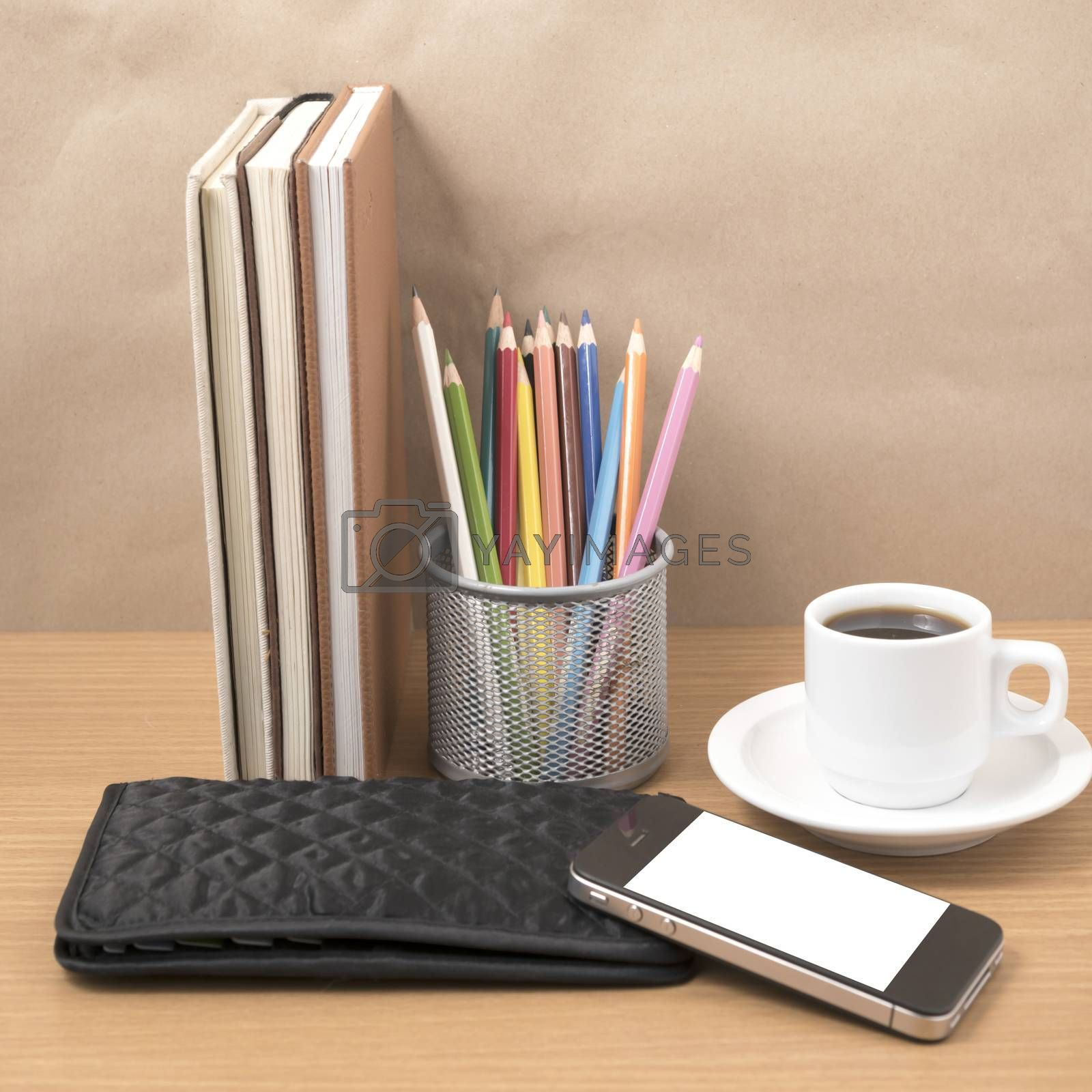 office desk : coffee with phone,stack of book,wallet,color box by Nisakorn Neera