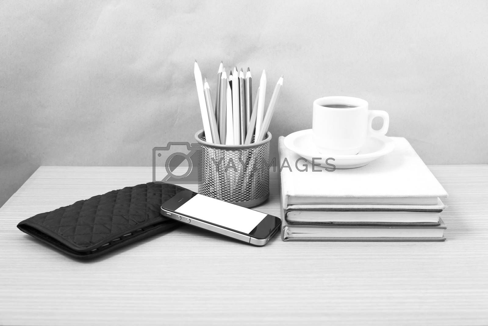 office desk : coffee with phone,stack of book,wallet,color box b by Nisakorn Neera