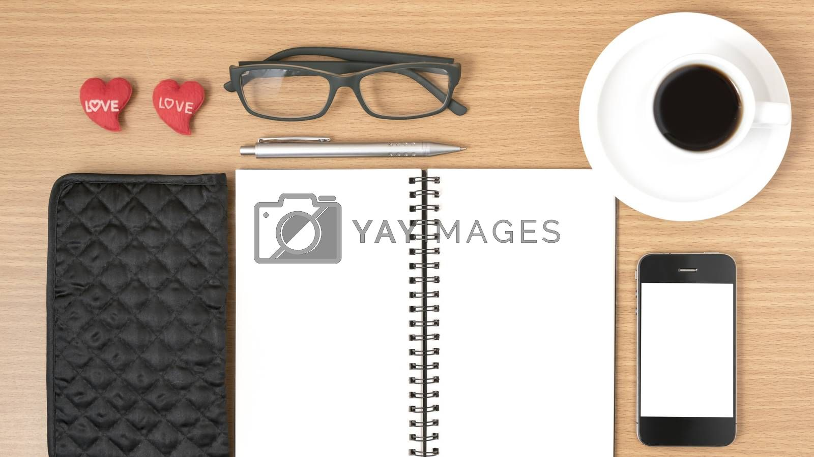 office desk : coffee with phone,notepad,eyeglasses,wallet,heart by Nisakorn Neera