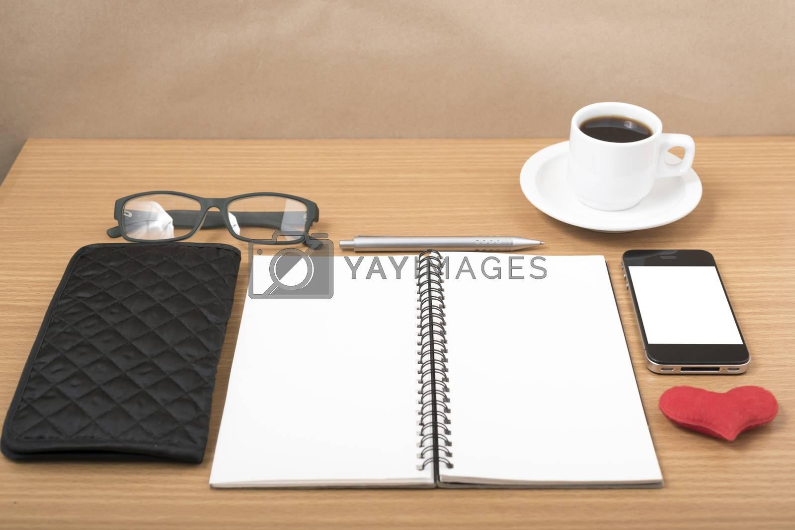 office desk : coffee with phone,notepad,eyeglasses,wallet,heart by Nisakorn Neera