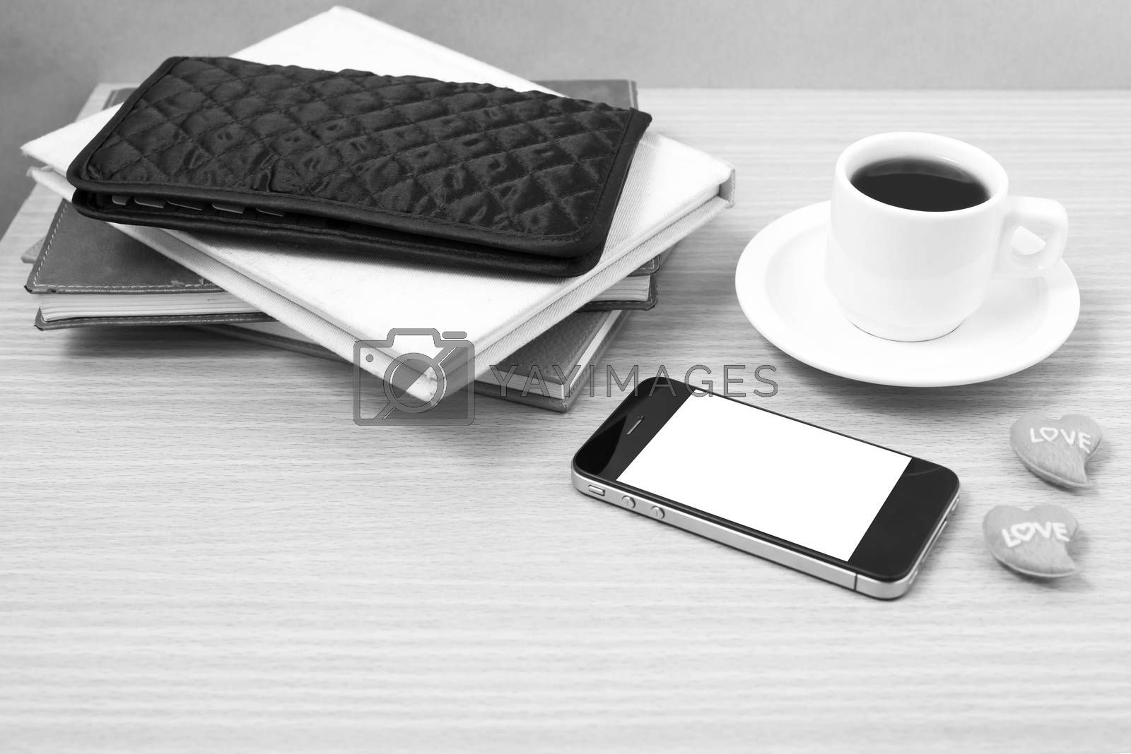 office desk : coffee with phone,heart,stack of book,wallet black by Nisakorn Neera