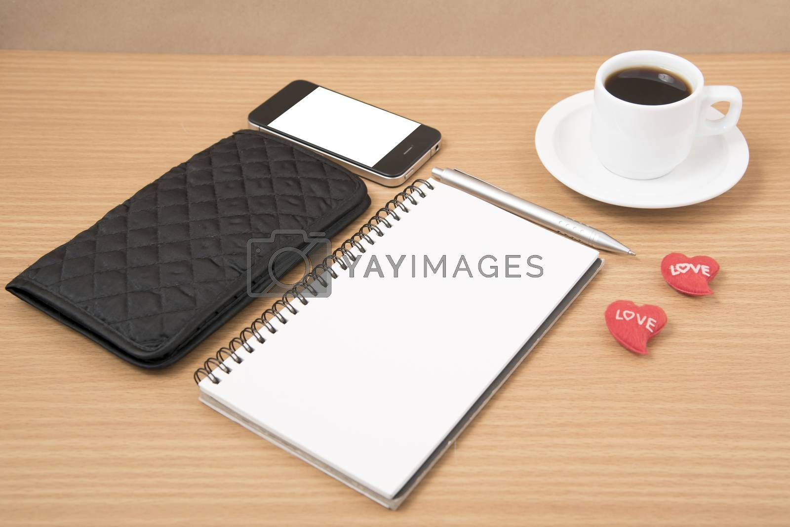 working table : coffee with phone,notepad,wallet and red heart by Nisakorn Neera