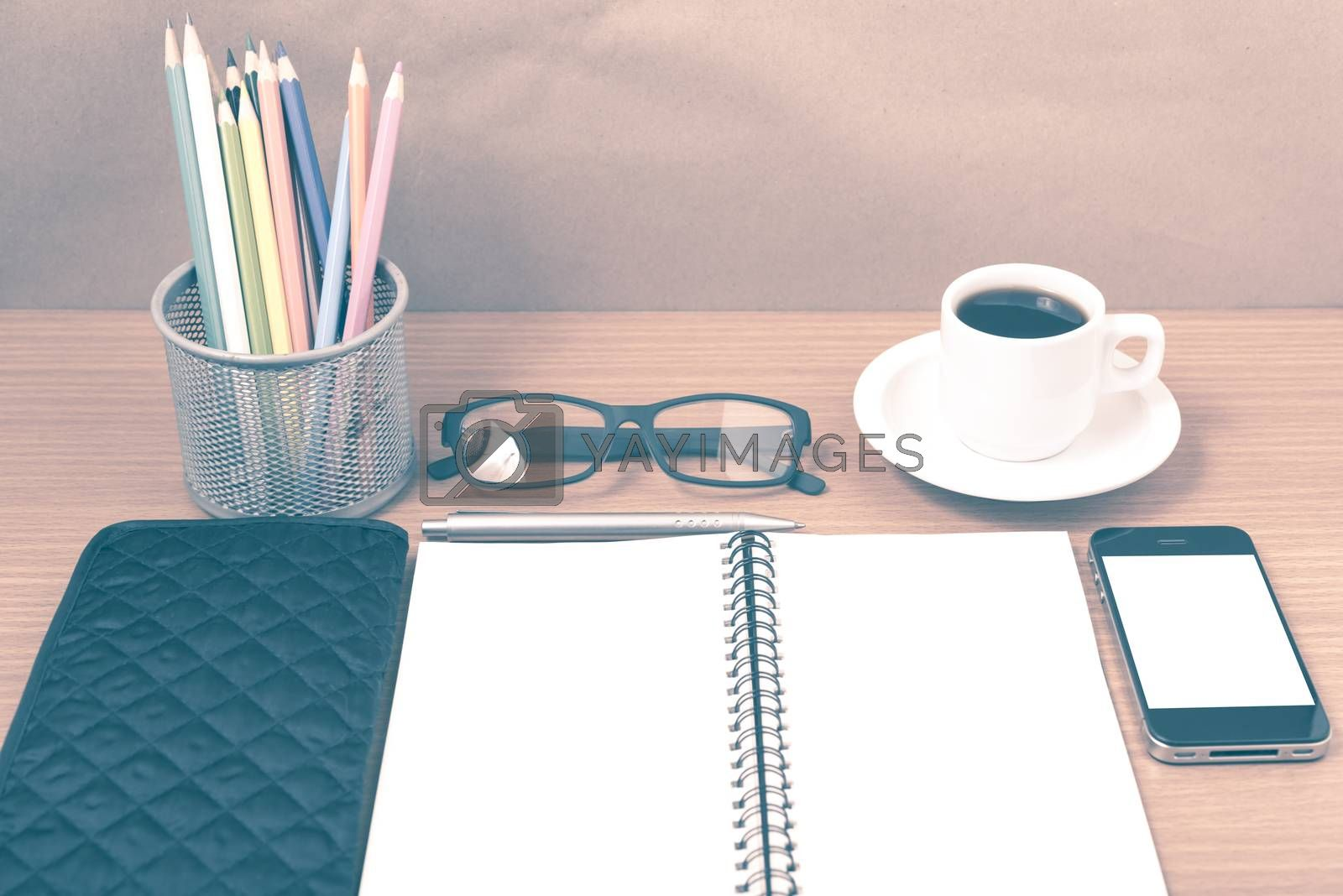 office desk : coffee with phone,notepad,eyeglasses,wallet,color  by Nisakorn Neera