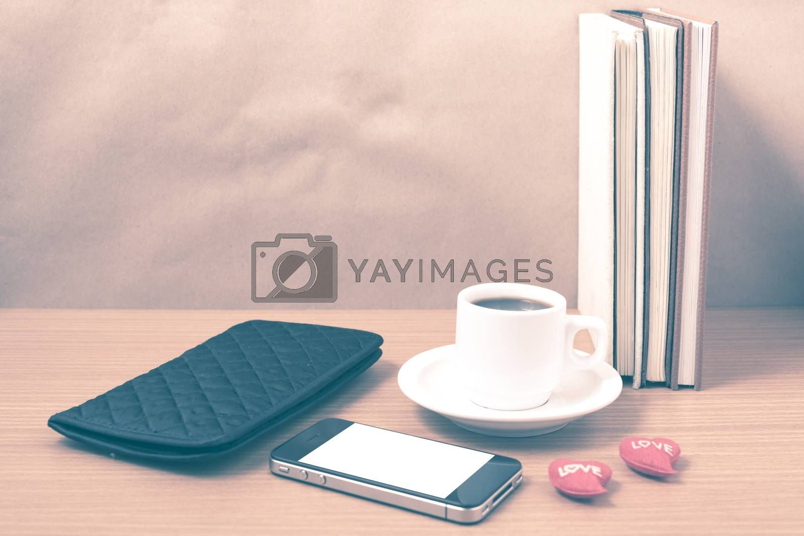 office desk : coffee with phone,heart,stack of book,wallet vinta by Nisakorn Neera