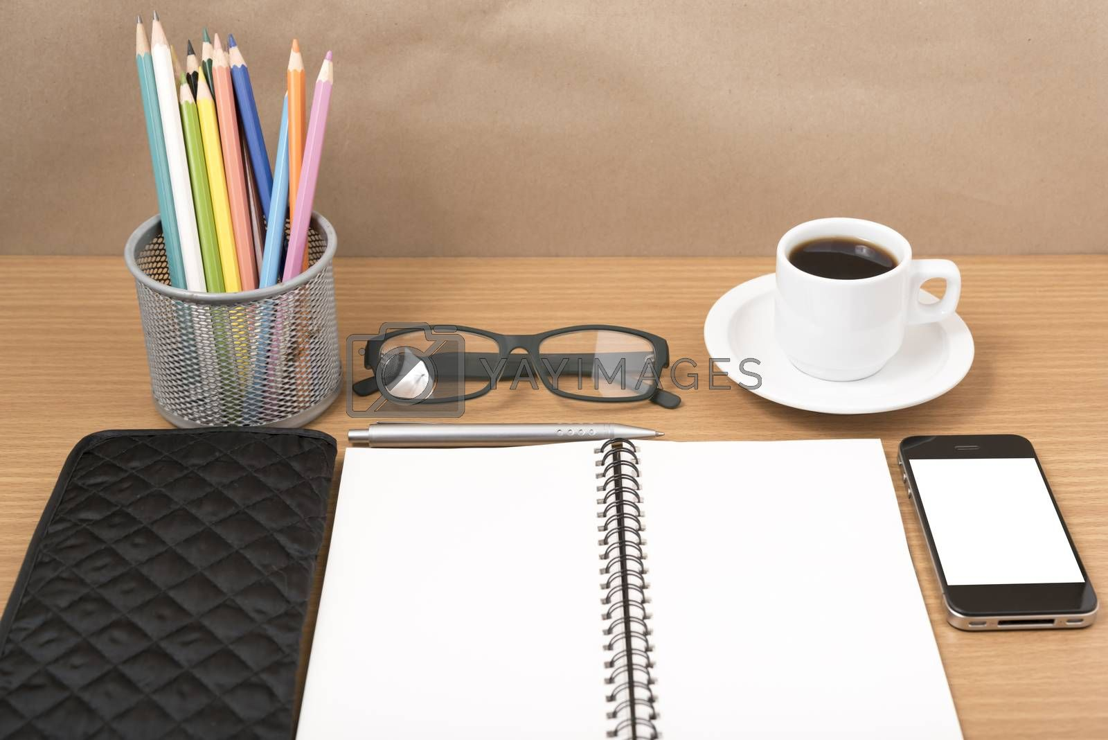 office desk : coffee with phone,notepad,eyeglasses,wallet,color pencil box on wood background