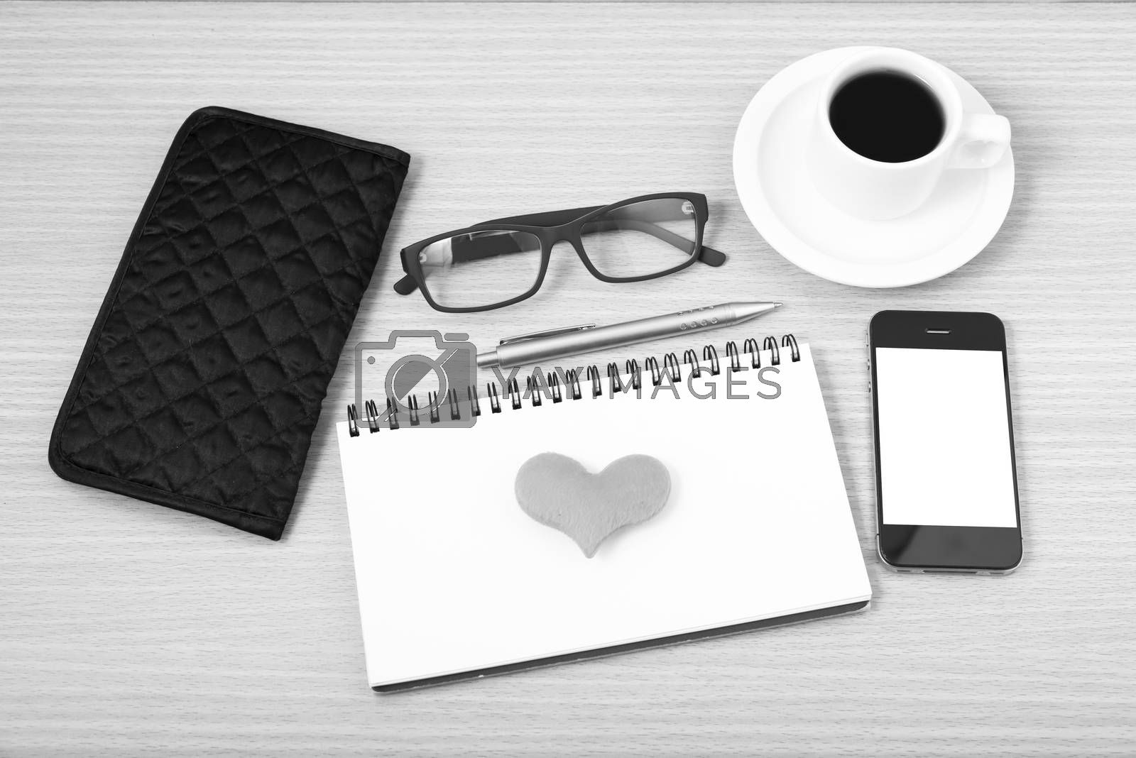 Royalty free image of office desk : coffee with phone,notepad,eyeglasses,wallet,heart  by ammza12