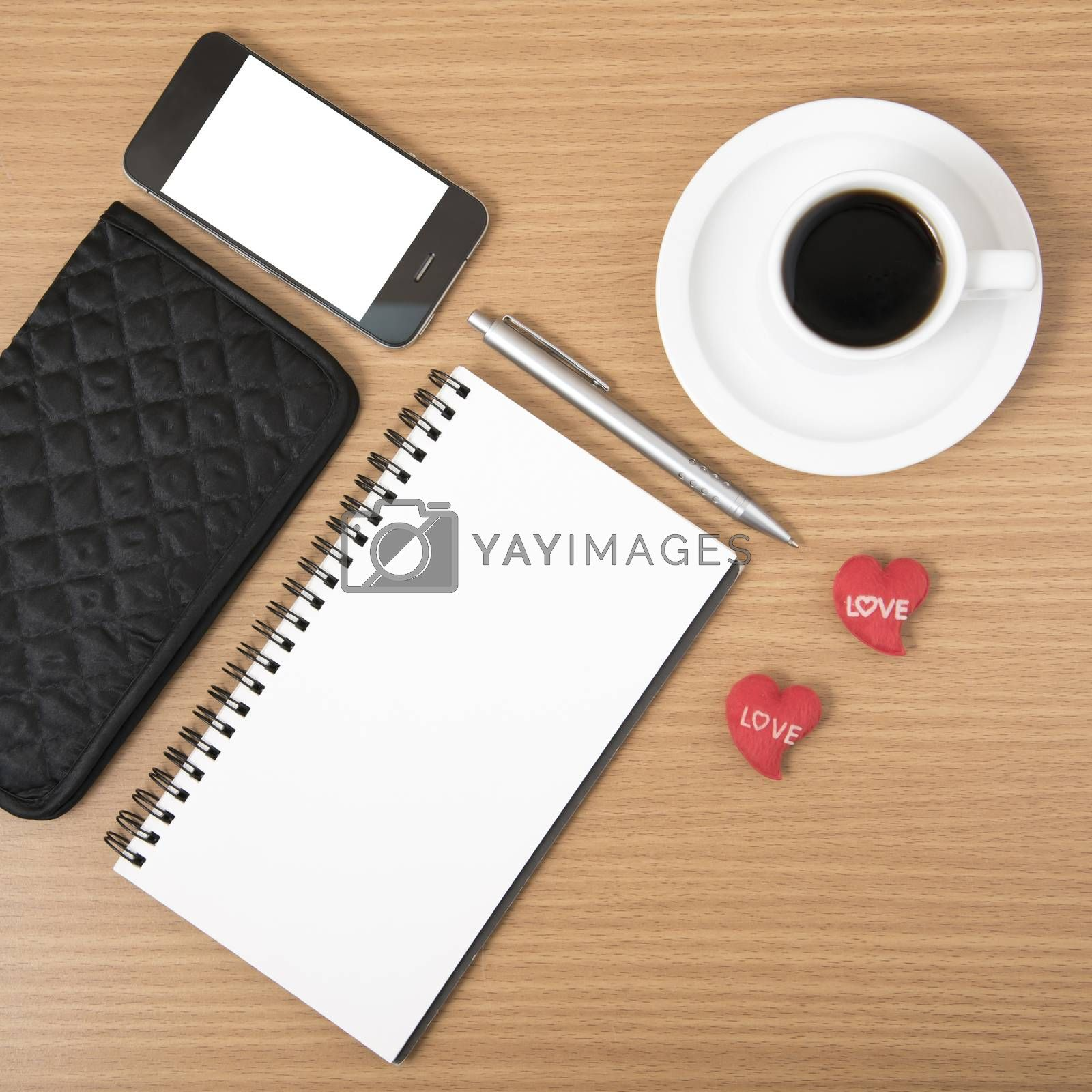 Royalty free image of working table : coffee with phone,notepad,wallet and red heart by ammza12