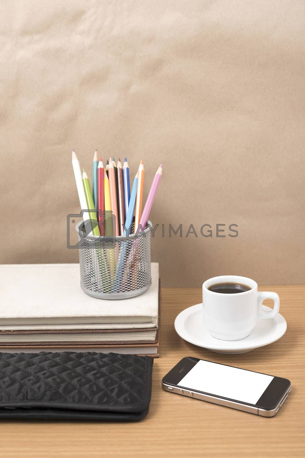 office desk : coffee with phone,stack of book,wallet,color box on wood background