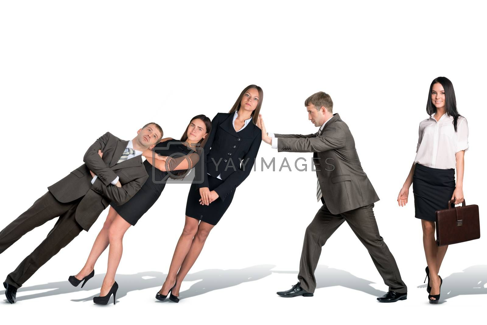 Businessman supporting falling paople isolated on white background