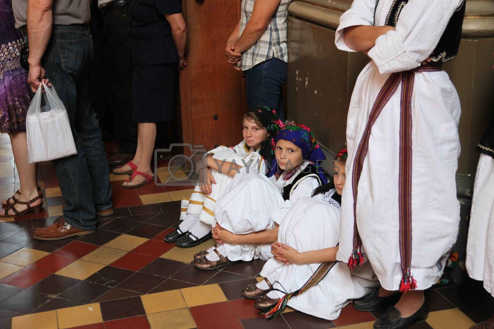 Unidentified participant in Croatian national costume on the Sunday Mass, during the Dakovacki vezovi (Dakovo Summer Festival) on July 05, 2009 in Dakovo, Croatia.