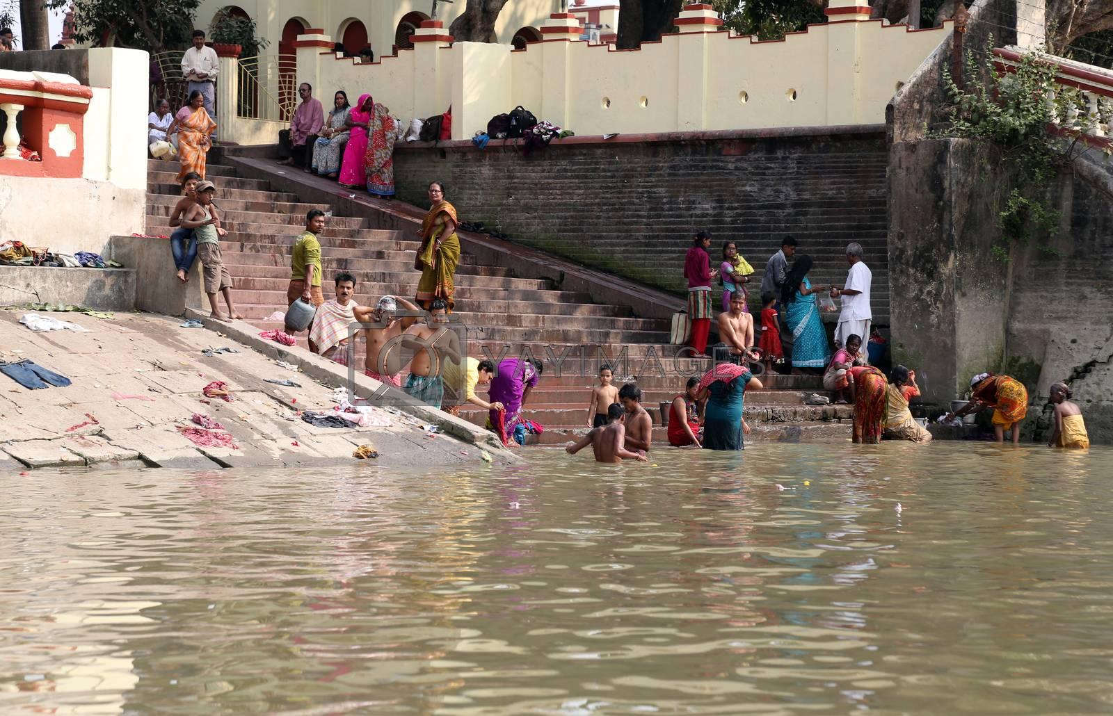 Hindu people bathing in the ghat near the Dakshineswar Kali Temple in Kolkata, West Bengal, India
