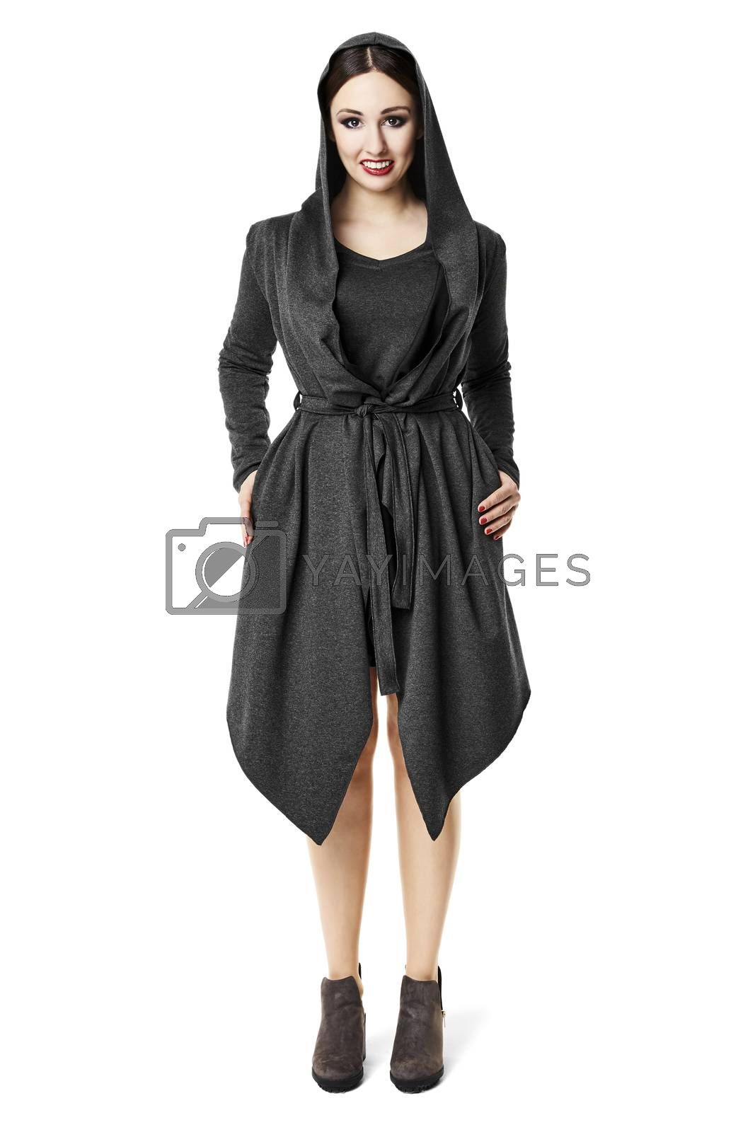 Studio shot of woman in black coat. Isolated on white background.