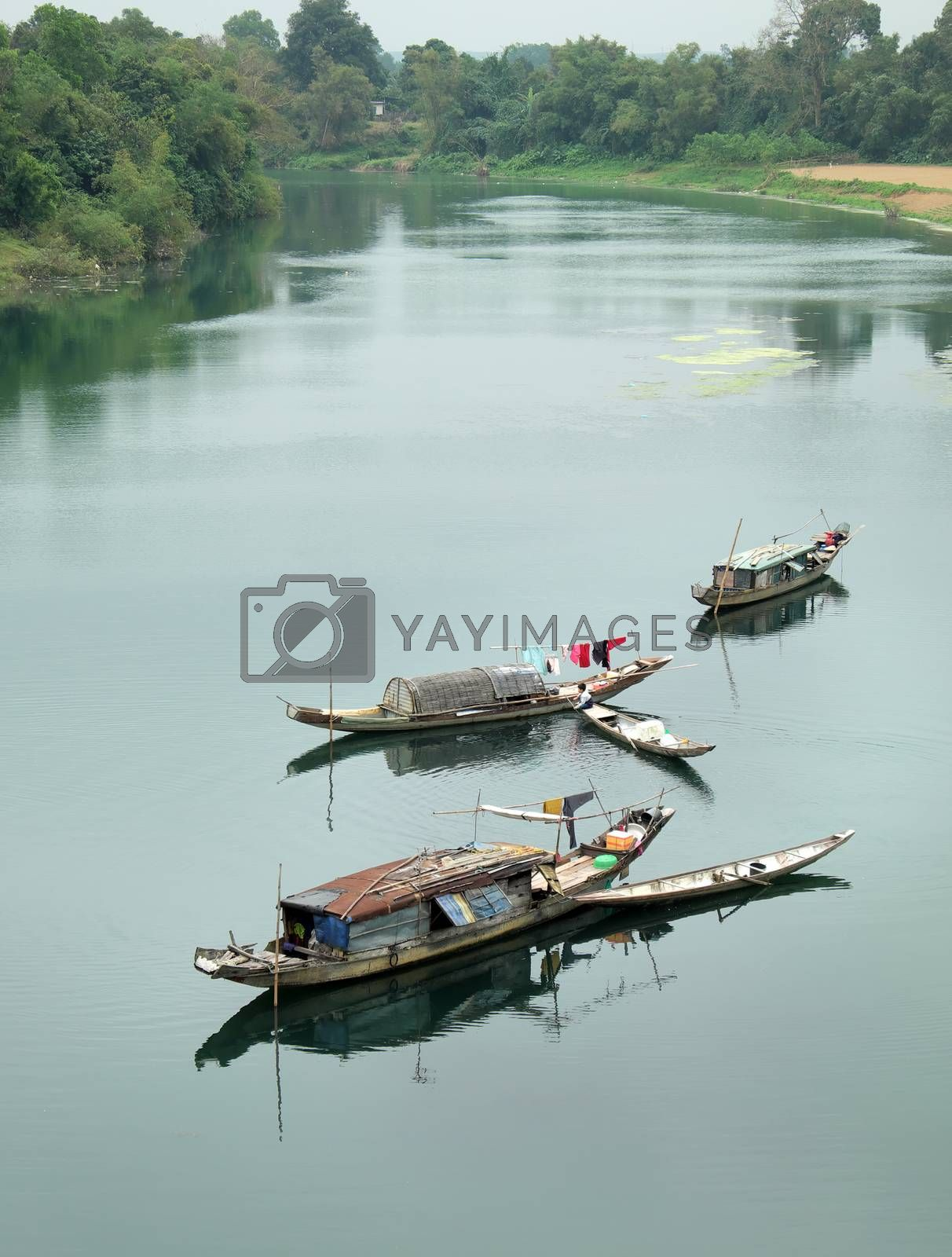 Beautiful landscape at Quang Binh countryside, Viet Nam on day, group of row boat floating on river at fishing village, poor Vietnam people work for live as fisherman and they live on water