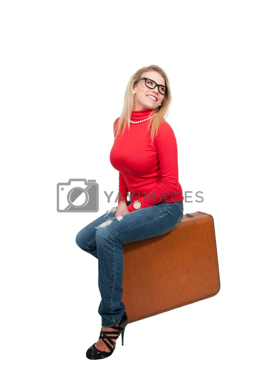 Beautiful young woman wearing glasses going on vacation with a suitcase