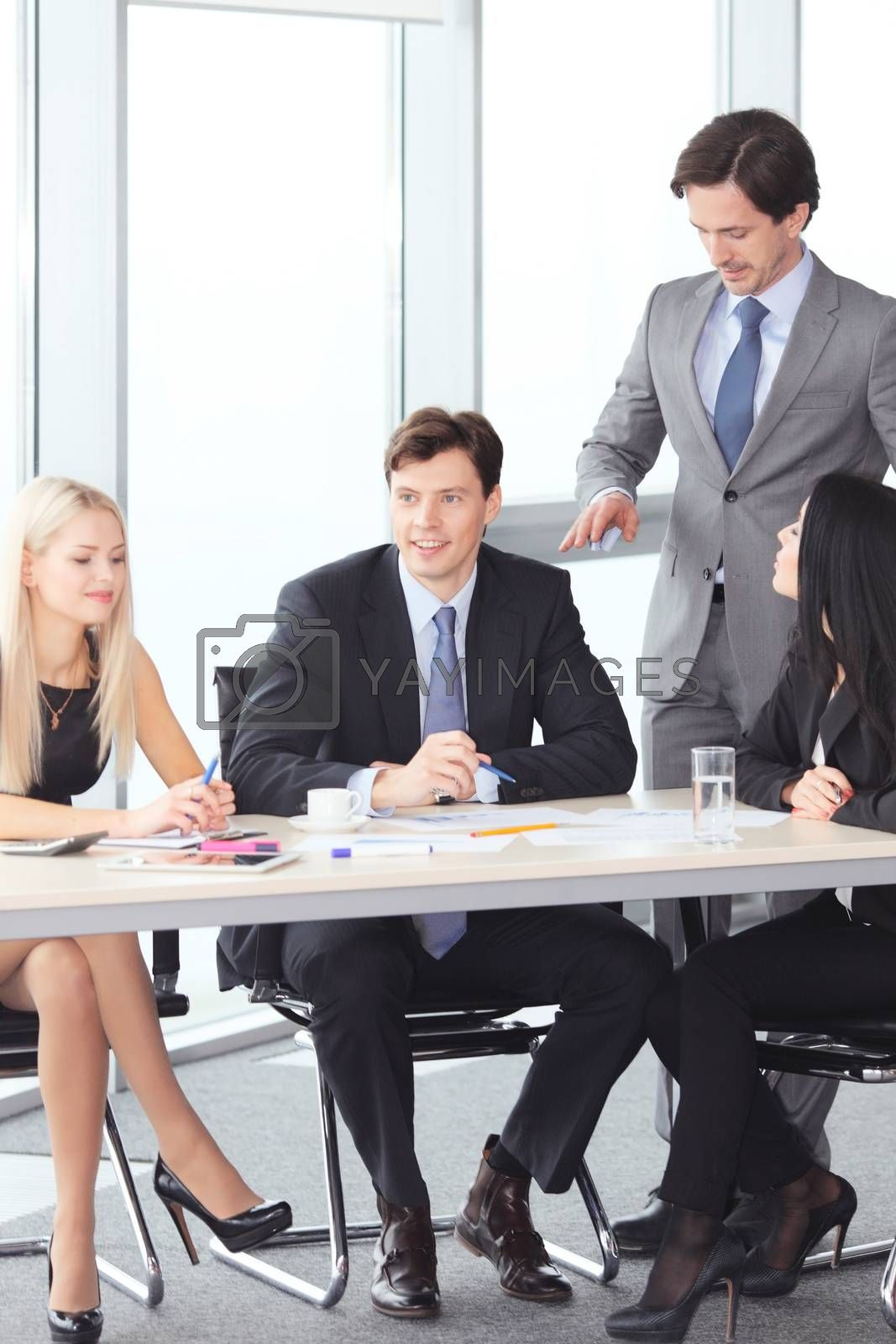 Business people discussing financial reports in office