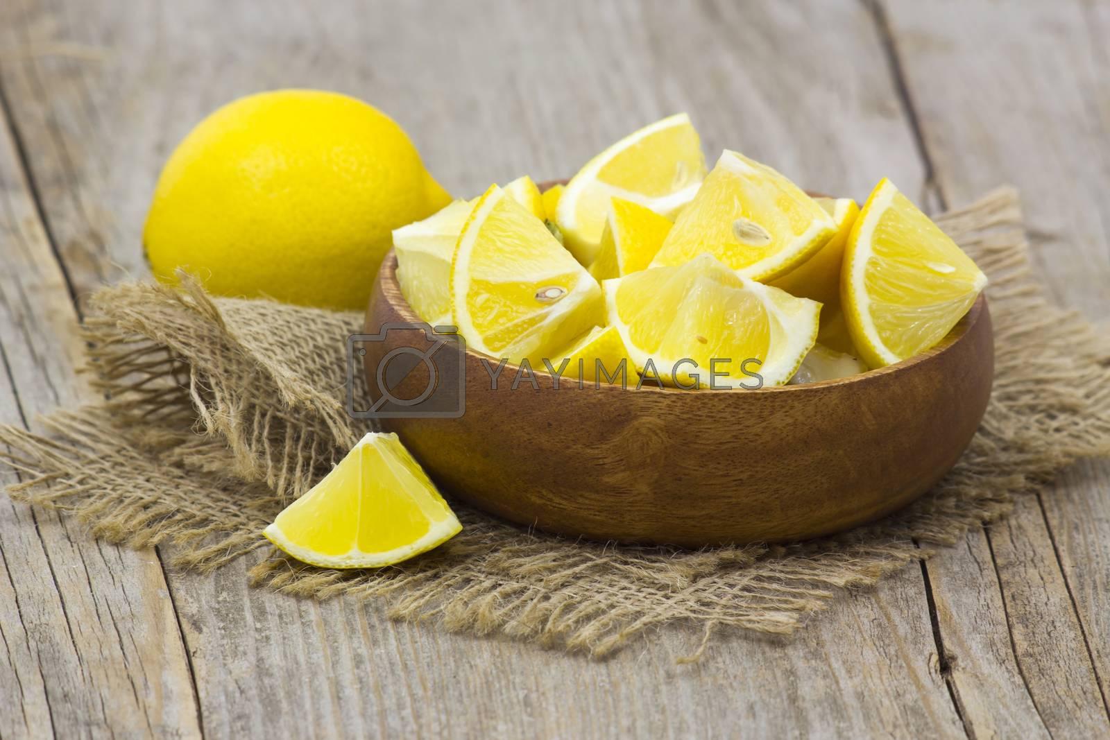 fresh lemons in a bowl  by miradrozdowski