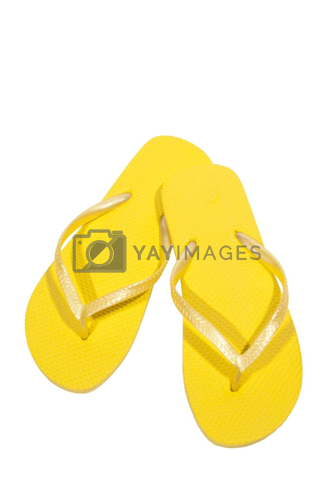 Vertical shot of yellow flip flops or thongs.  Isolated on white.