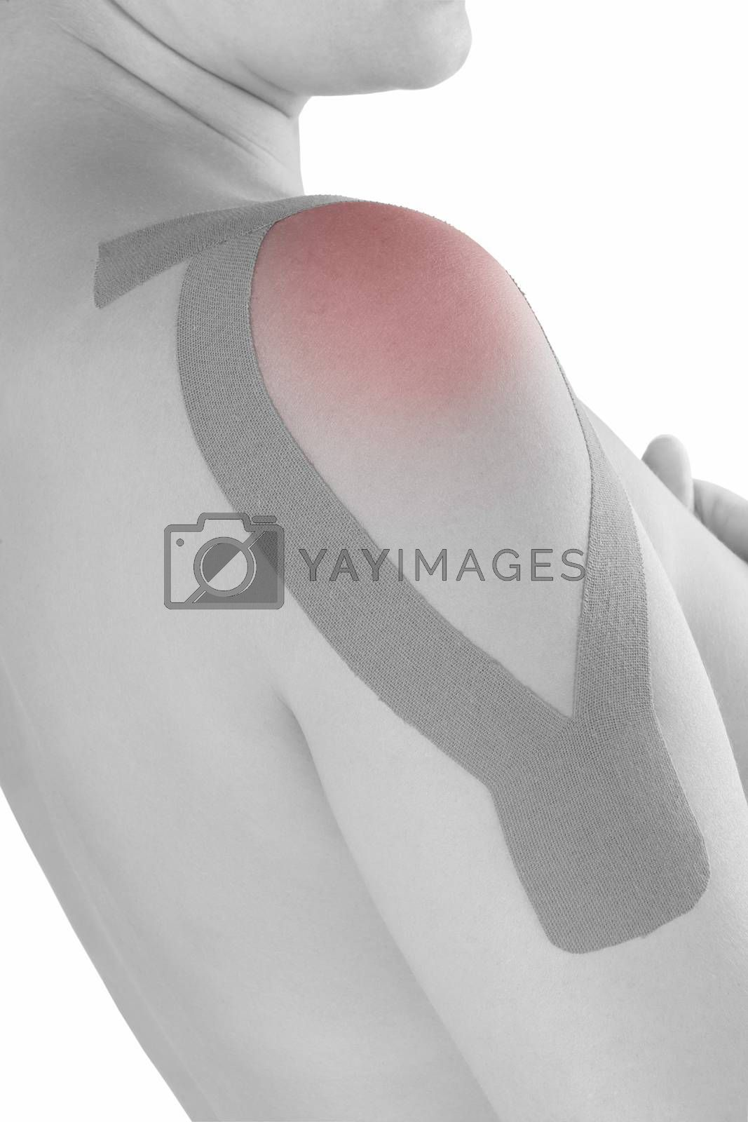 Therapeutic tape on shoulder on beautiful caucasian woman. Alternative medicine, rehabilitation.