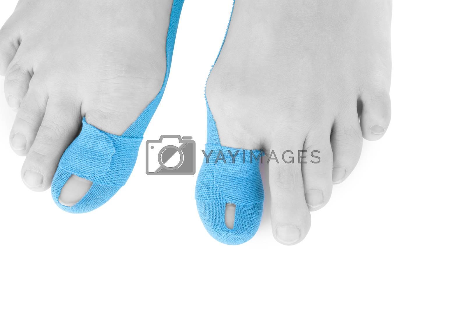 Therapeutic tape on female toe isolated on white background. Chronic pain, alternative medicine. Rehabilitation and physiotherapy.