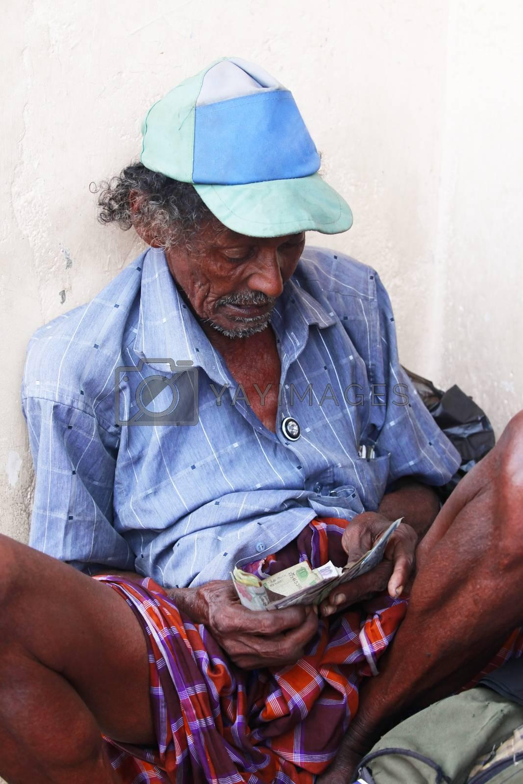 Colombo, Sri Lanka - April 9, 2011: Drunk old the beggar in the street on Sri Lanka