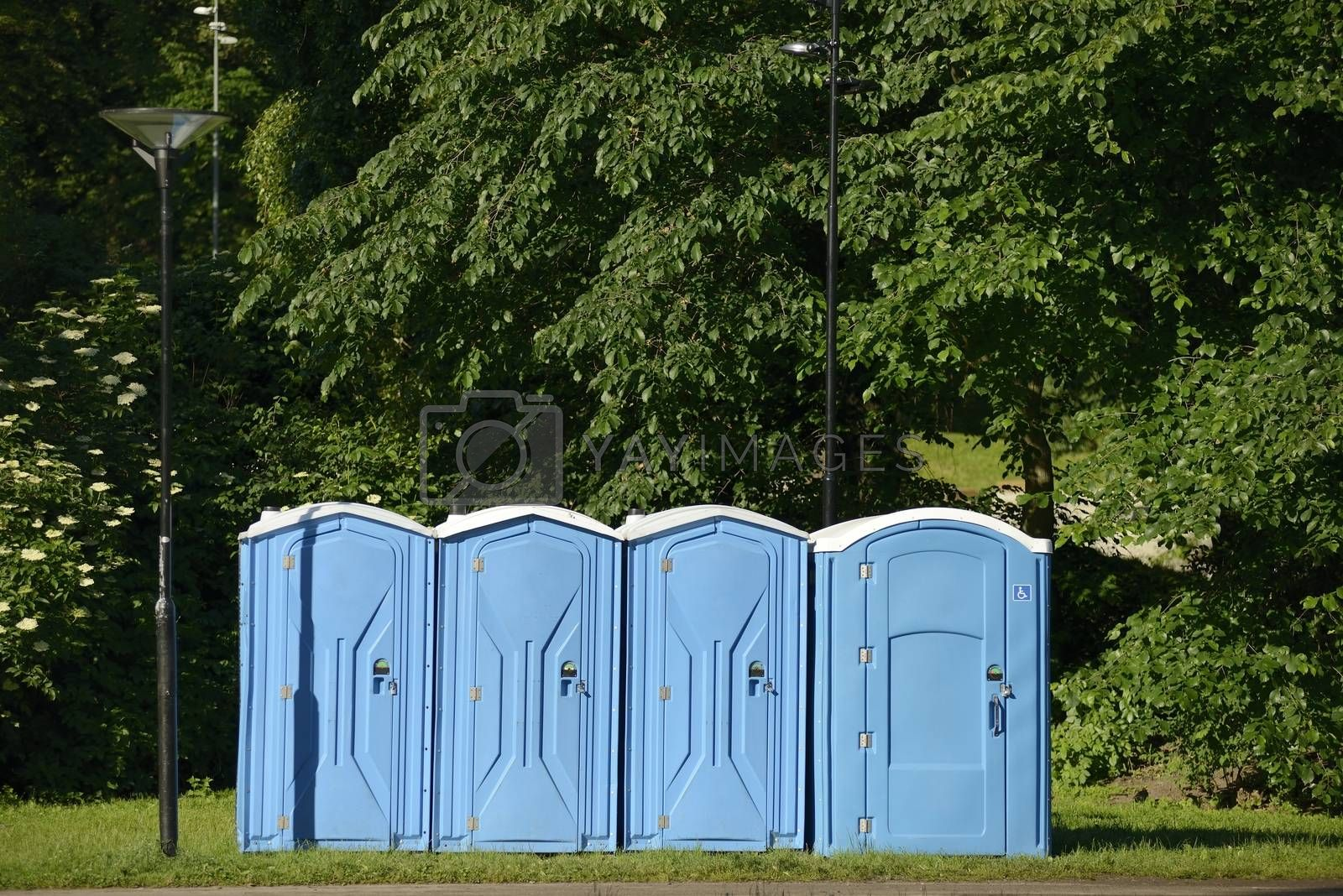 Old blue mobile toilet cabins