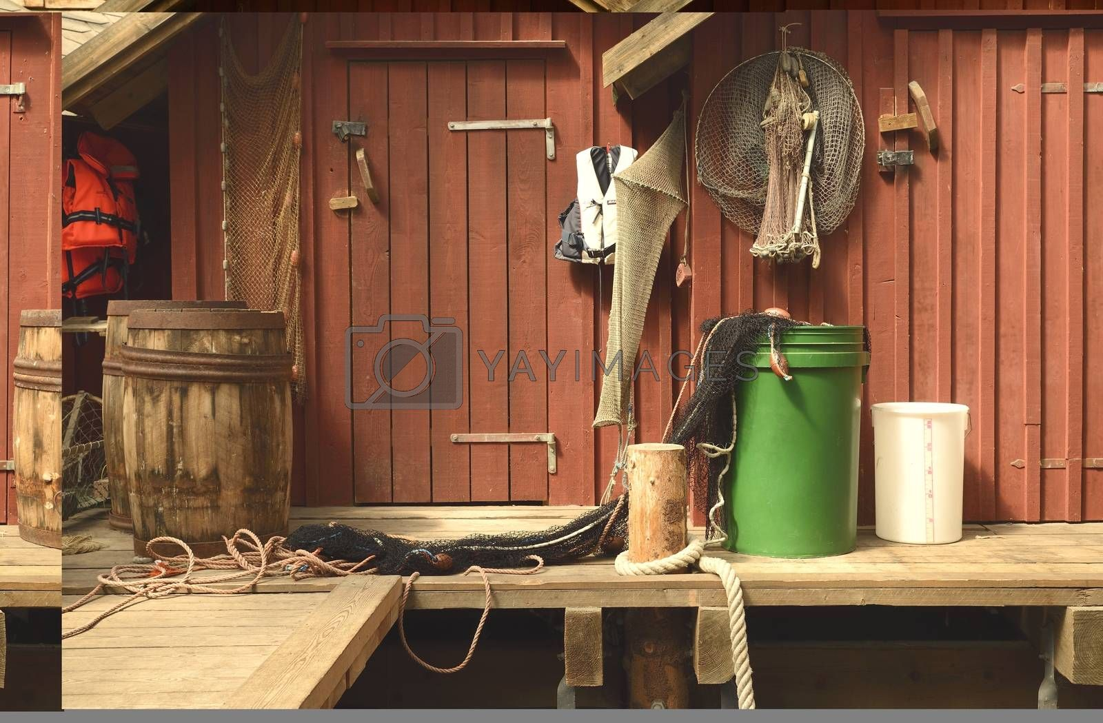 A set of fishing gear and net hanging on the wall in a Swedish fiserman village.