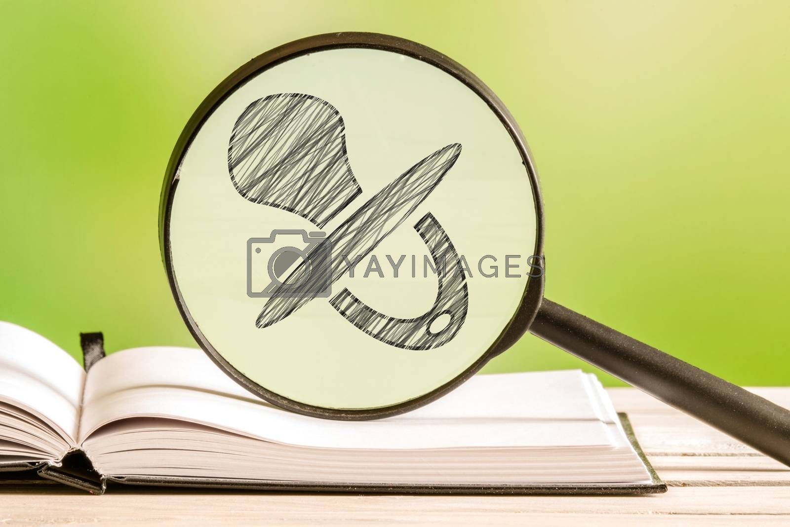 Baby information with a pencil drawing of a pacifier in a magnifying glass