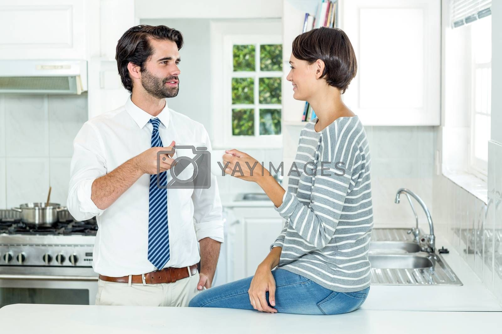 Royalty free image of Woman interacting with businessman during coffee break by Wavebreakmedia