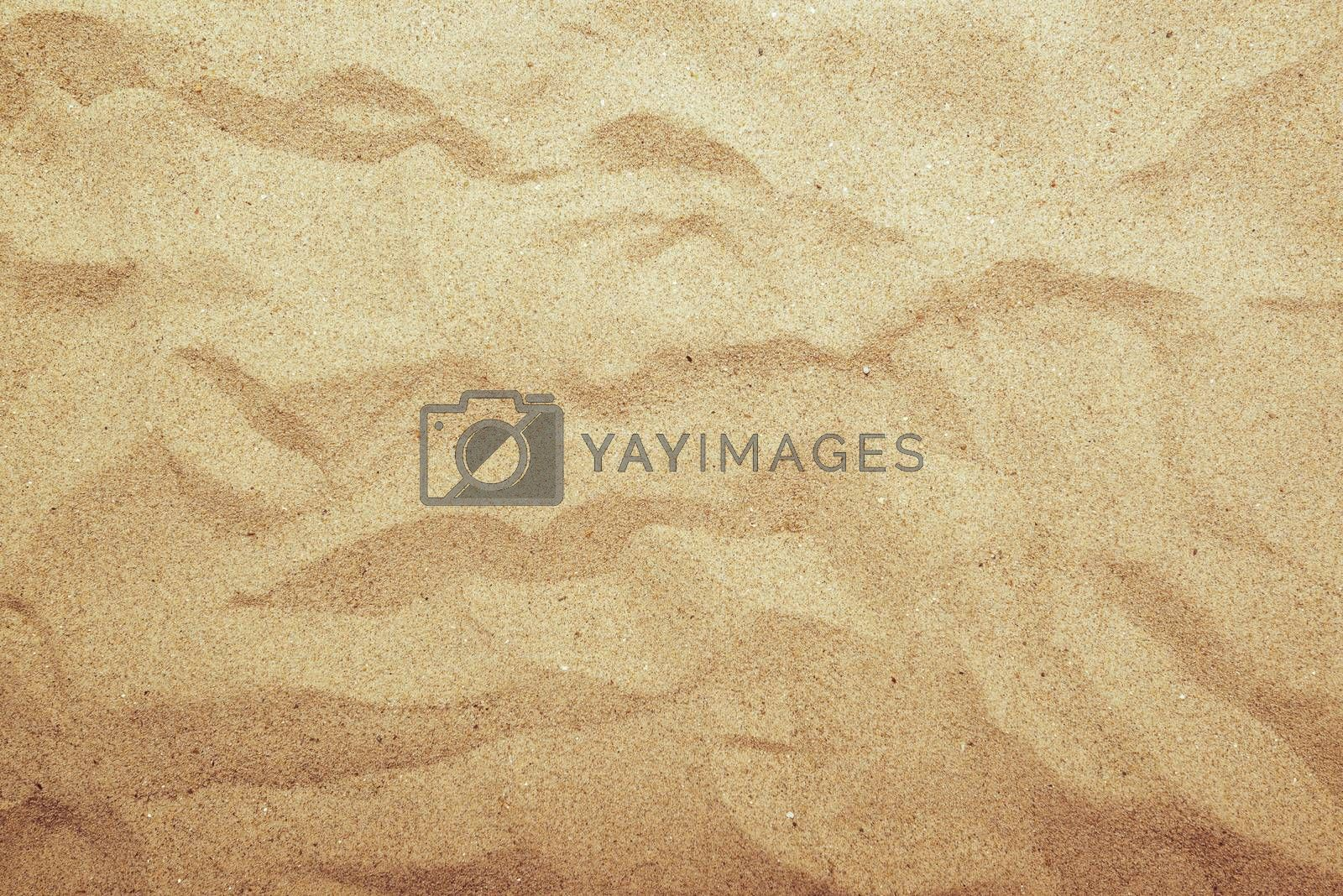 Sand texture, top view of summer beach sand surface with gradient light.