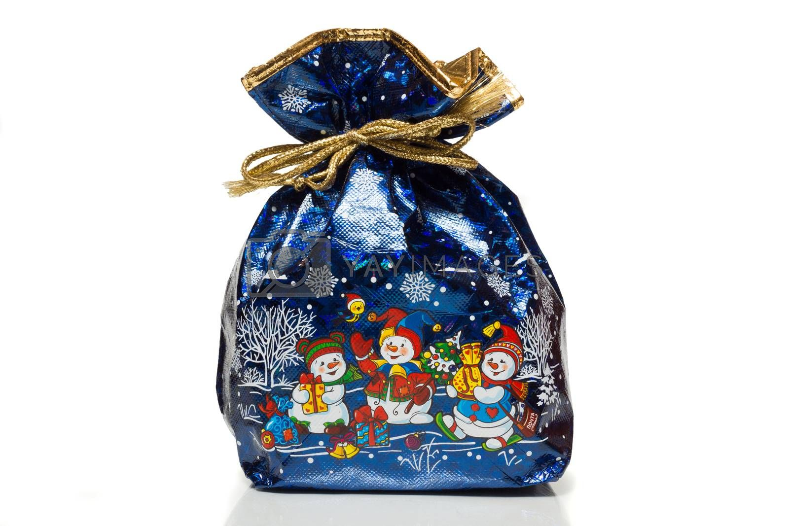 The photo depicts a bag with gifts