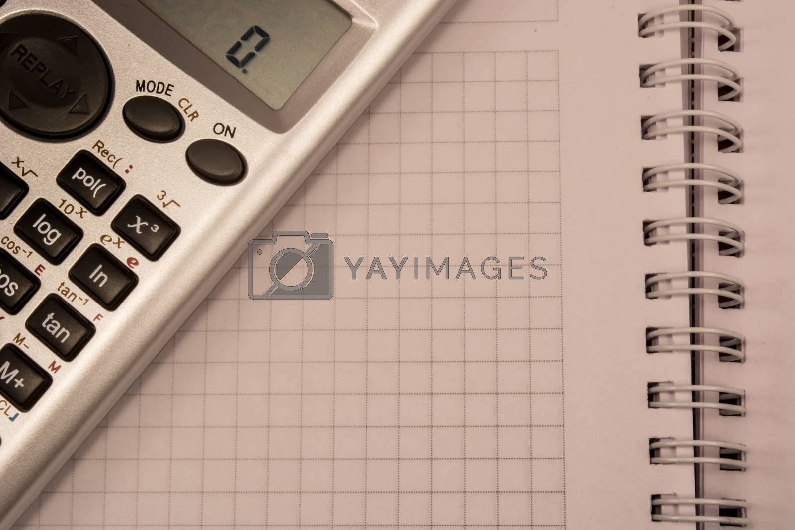 Calculator and white empty notebook, ready to be filled