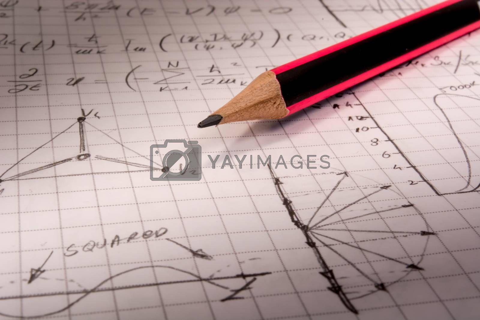 Pencil on notebook,   full of mathematical formulas