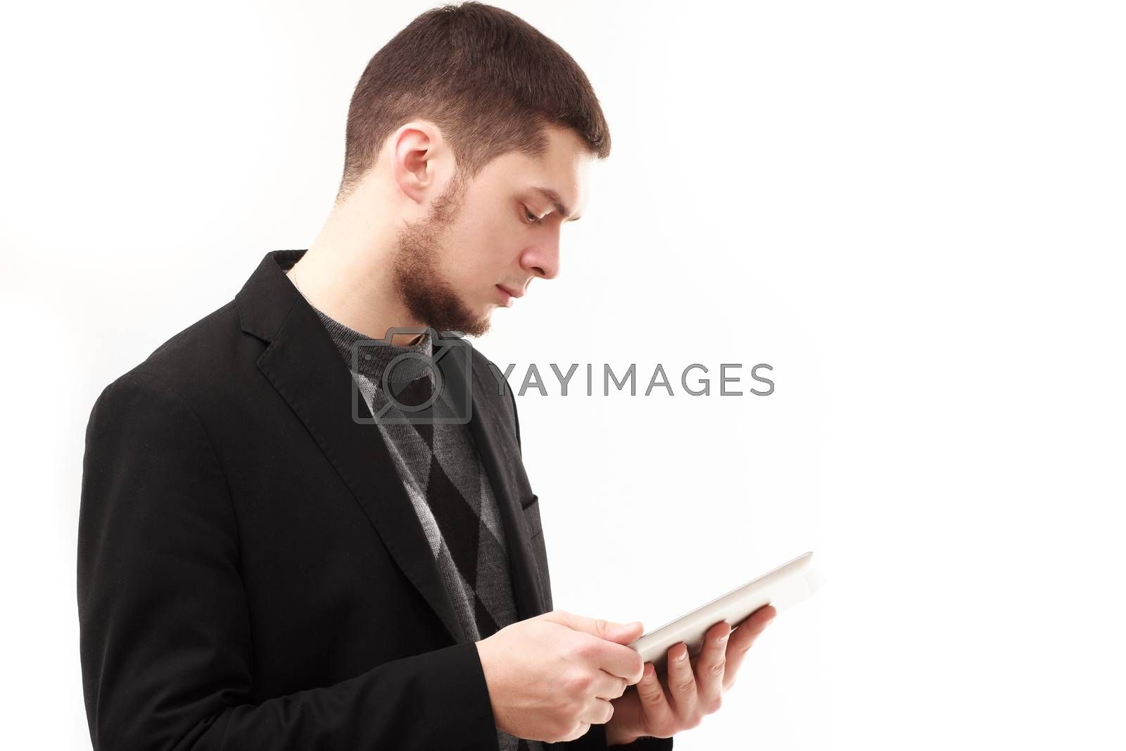Casual businessman using his tablet  isolated on white