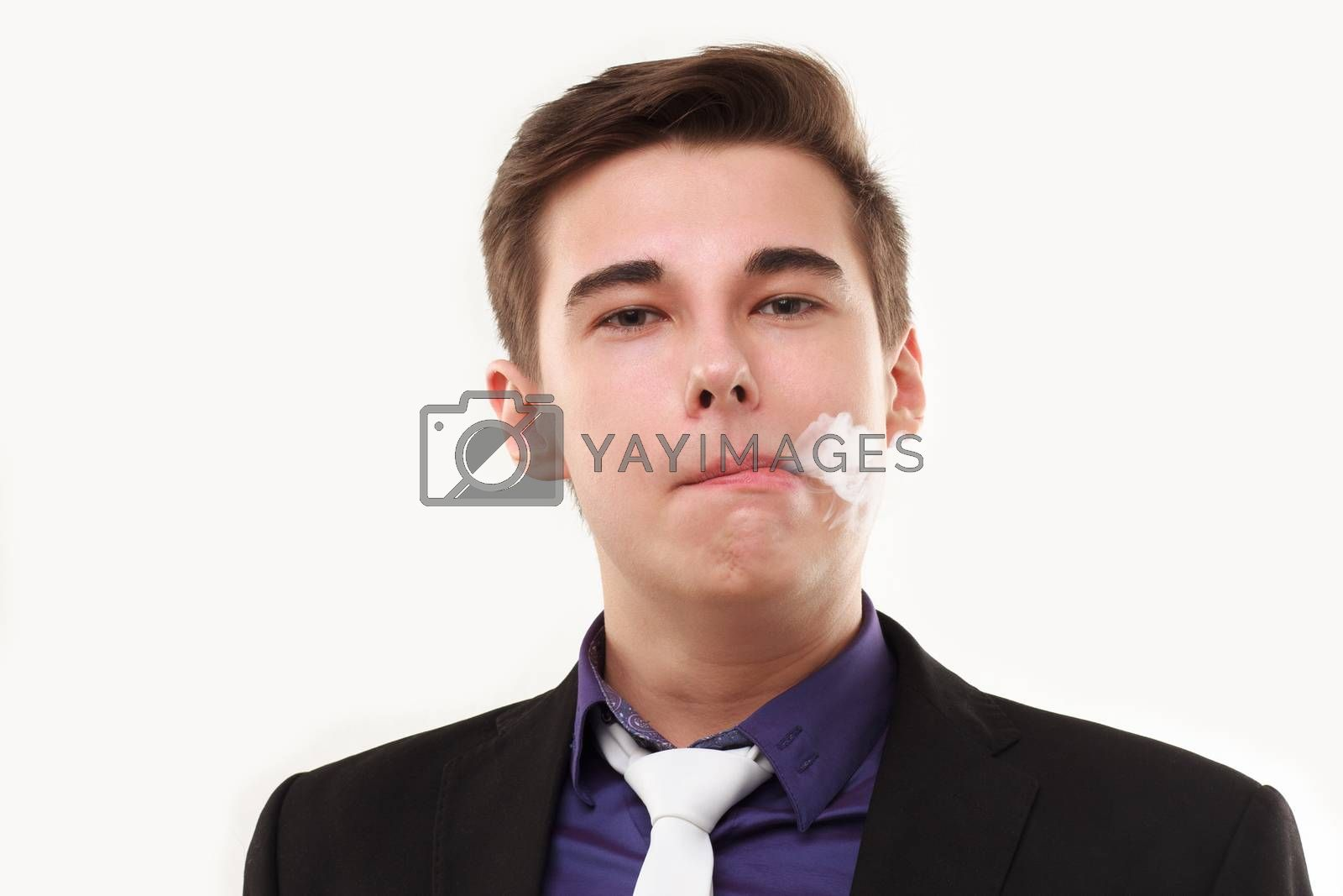 Portrait of a man in suit smoking an e-cigarette isolated on white. Let the steam out of his mouth