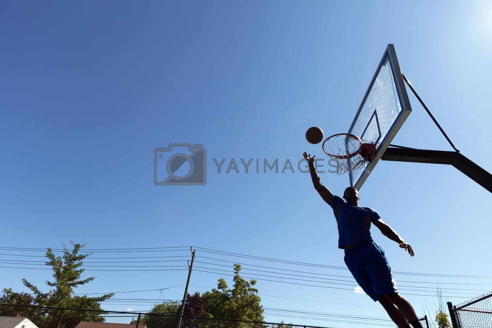 Basketball Layup Silhouette by graficallyminded