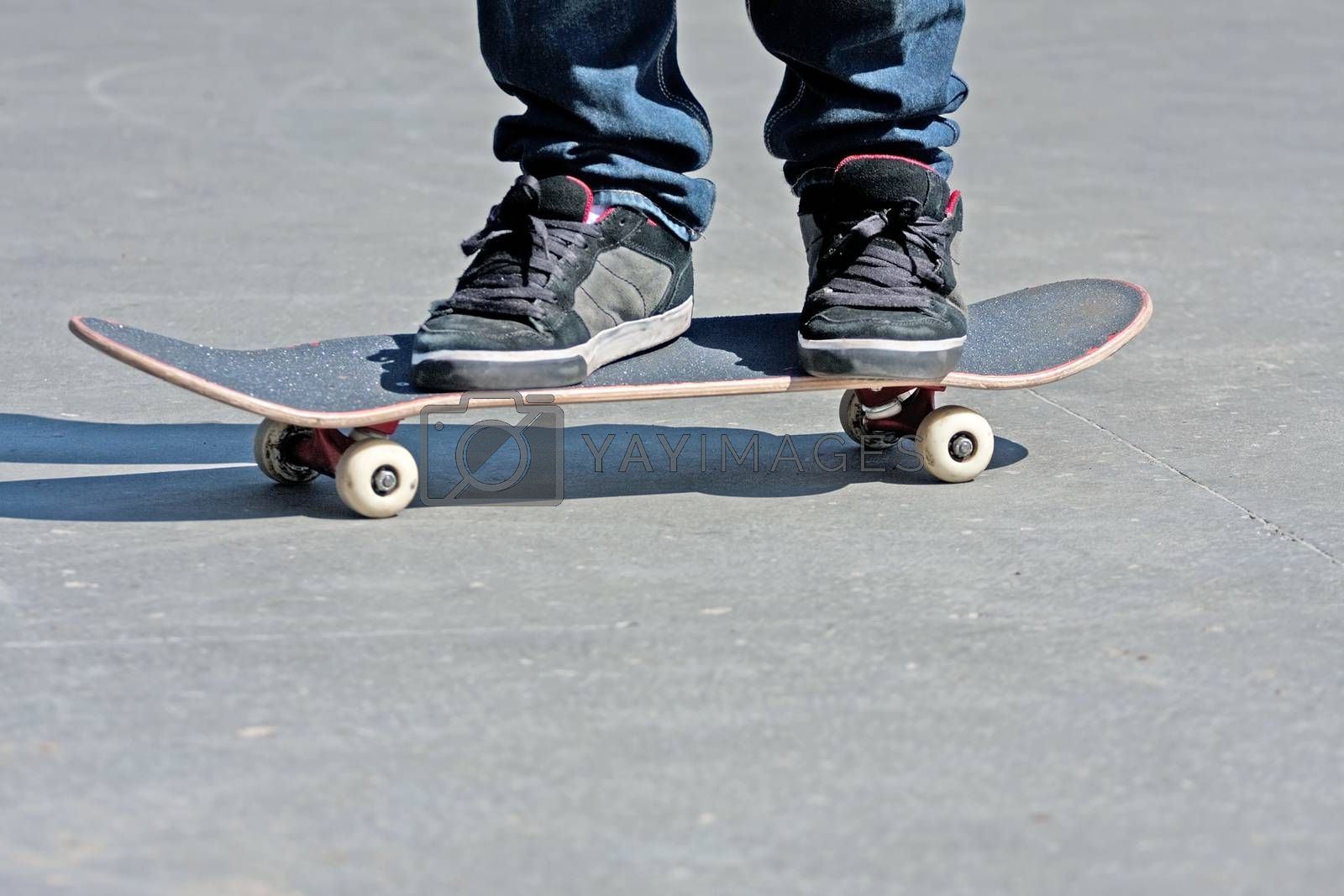 Royalty free image of Skateboarders Feet Close Up by graficallyminded