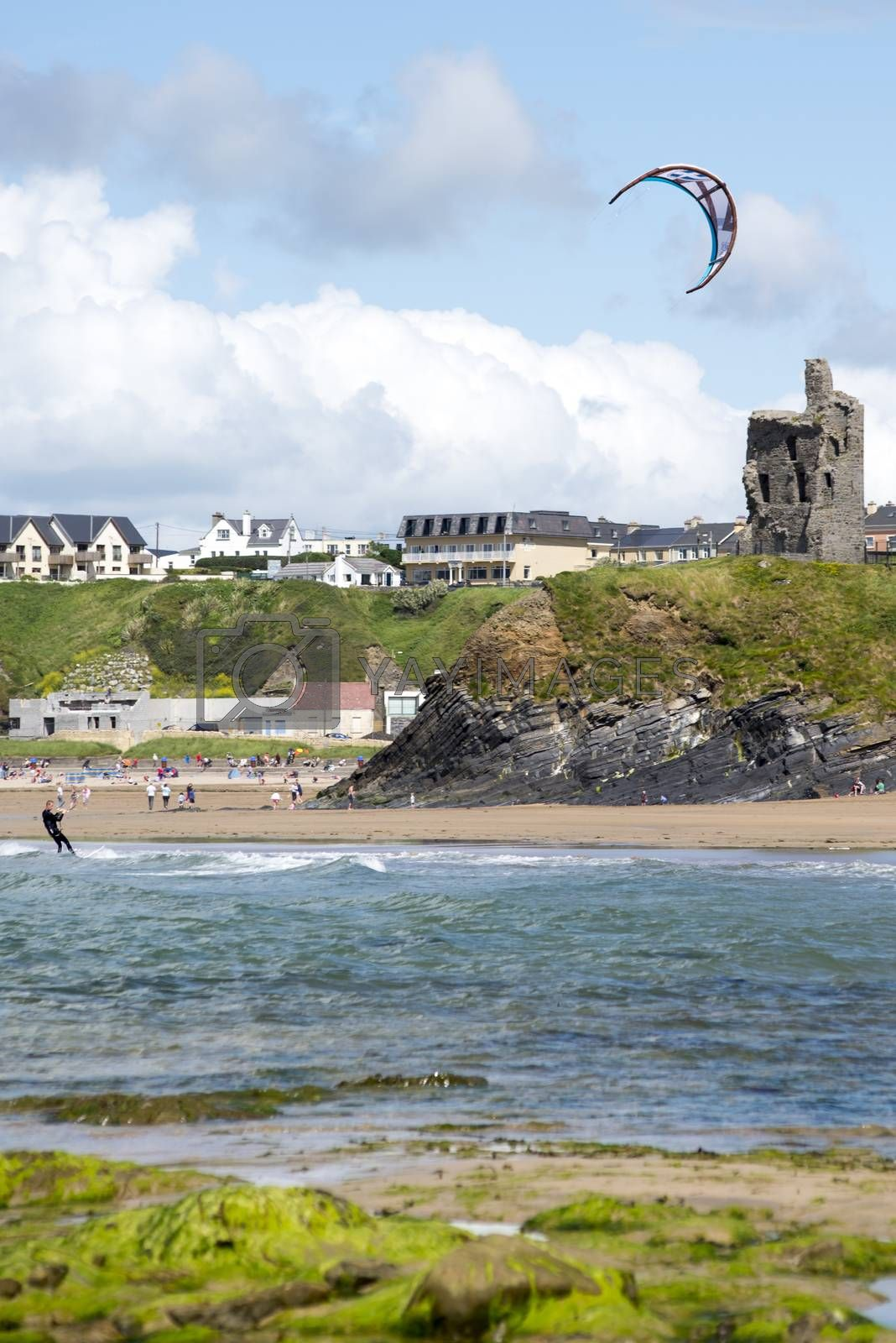 lone kite surfer playing the waves at ballybunion beach on the wild atlantic way