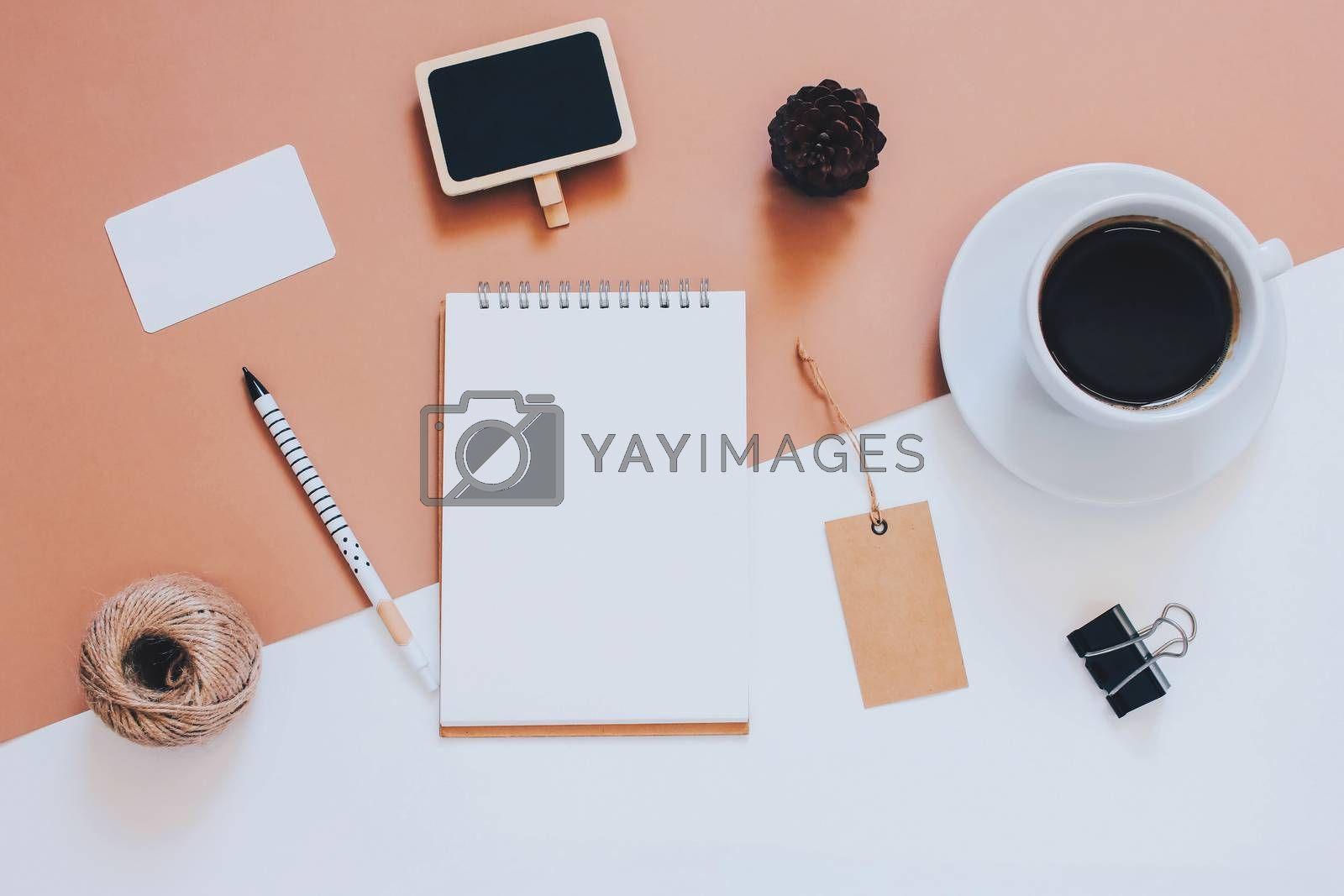 Creative flat lay photo of workspace desk with smartphone, coffee, tag and notebook with copy space background, minimal styled