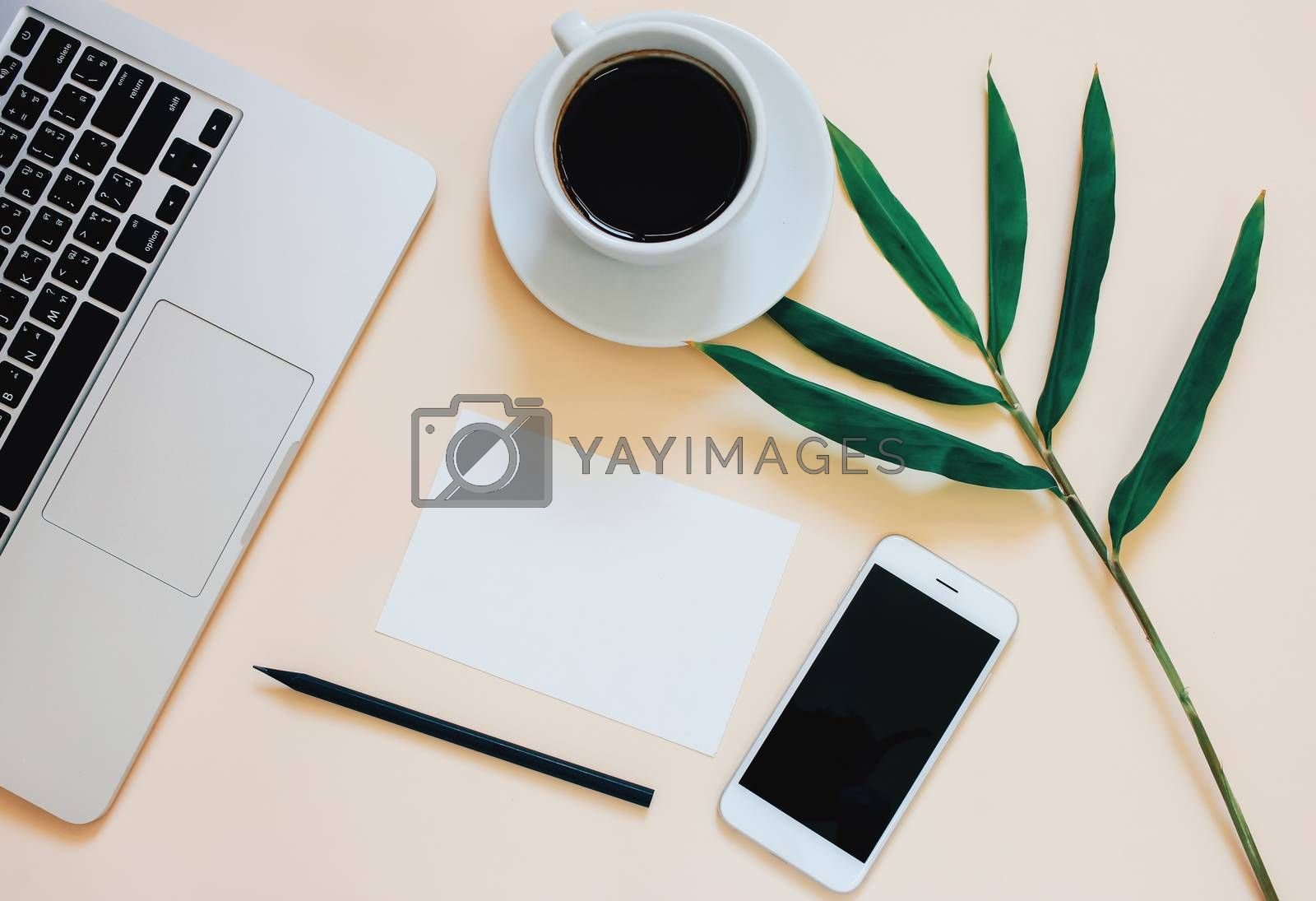 Creative flat lay photo of workspace desk with laptop, smartphone, coffee and blank paper with copy space background, minimal style