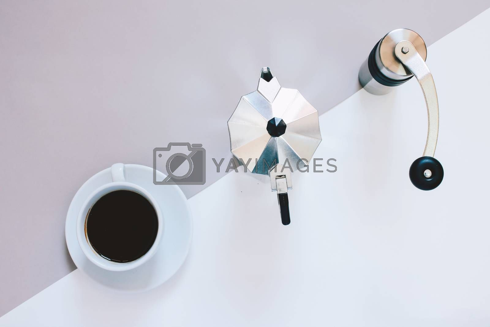 Creative flat lay photo of coffee workspace with coffee maker, coffee grinder and black coffee,  minimal style