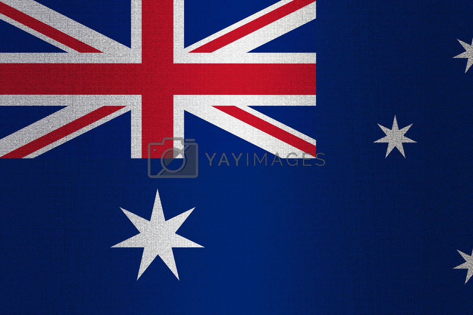 Flag of Australia on a stone wall background.