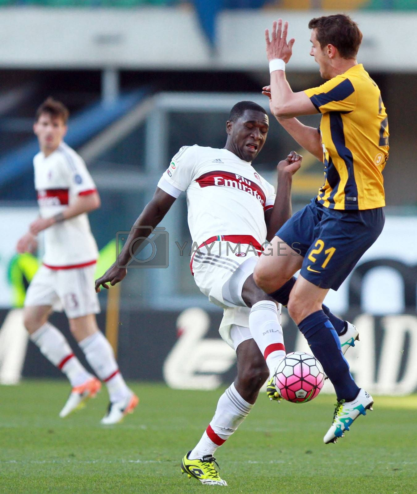ITALY, Verona: Milan's defender Christian Zapata (L) vies with Hellas Verona's forward Gomez Taleb Juan Ignacio (R) during the Serie A match between FC Hellas Verona v AC Milan on April 25, 2016. Luca Siligardi scored on a late free kick to secure the win for his team in the 95th minute.