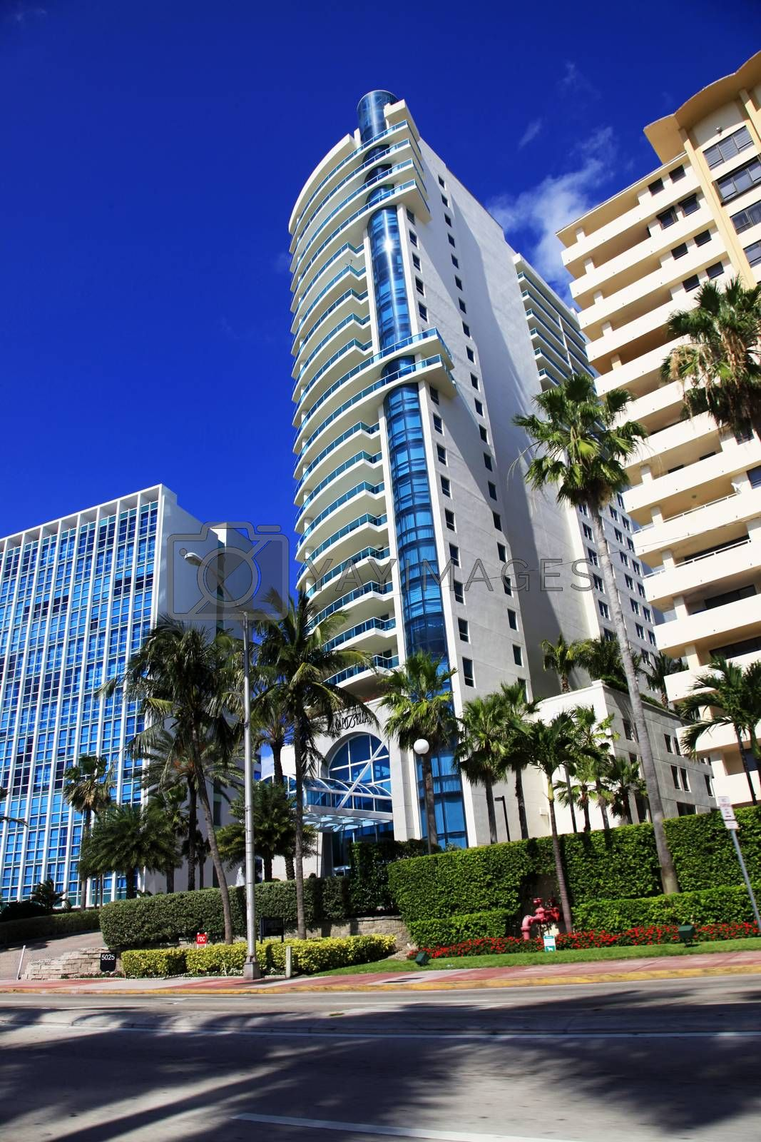 """Miami, Florida, USA - May 14, 2013: Luxurious apartment building """"Capobella"""" at 5025 Collins Avenue was constructed by Architect Stuart Cohen in 1995, may 14, 2013 in Miami, Florida."""