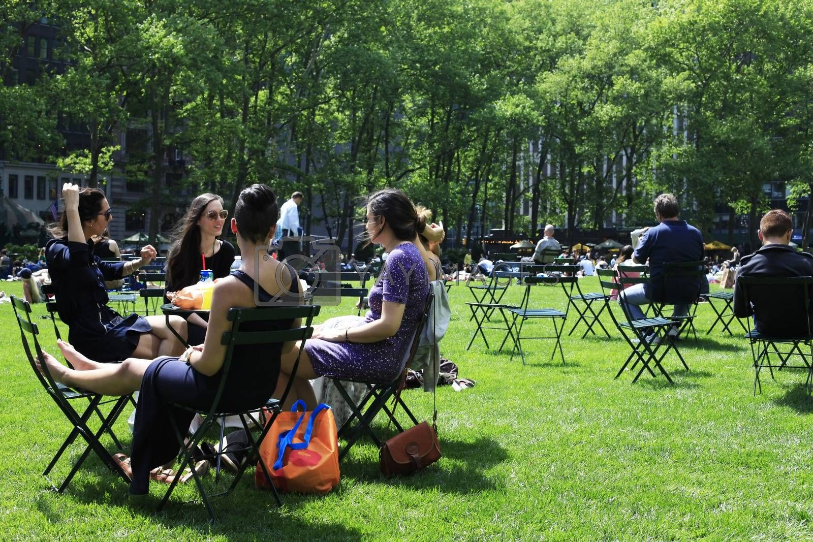 York City, NY, USA - May 16, 2013: People enjoying a nice day in Bryant Park on May 16, 2013 in New York City, NY. Bryant Park is a 9,603 acre privately managed park in the center of Manhattan.