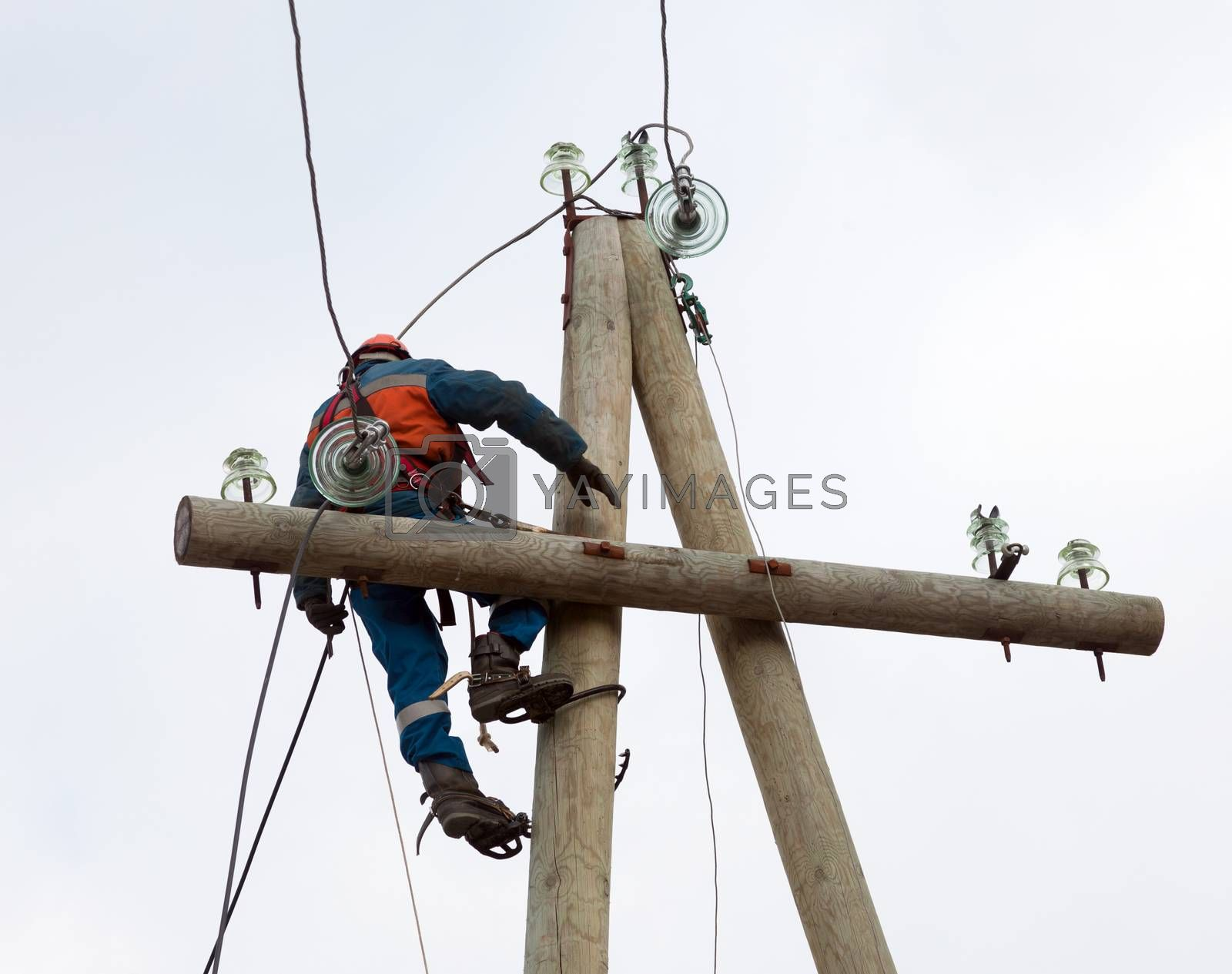 electrician working on the power lines after the accident  with the use of special tools