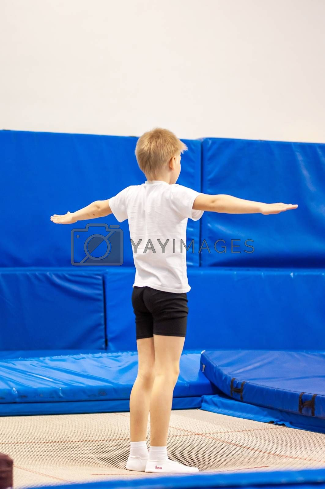Orenburg, Russia - 30 April 2016: The boys compete in jumping on the trampoline on competitions at the Orenburg region among Juniors