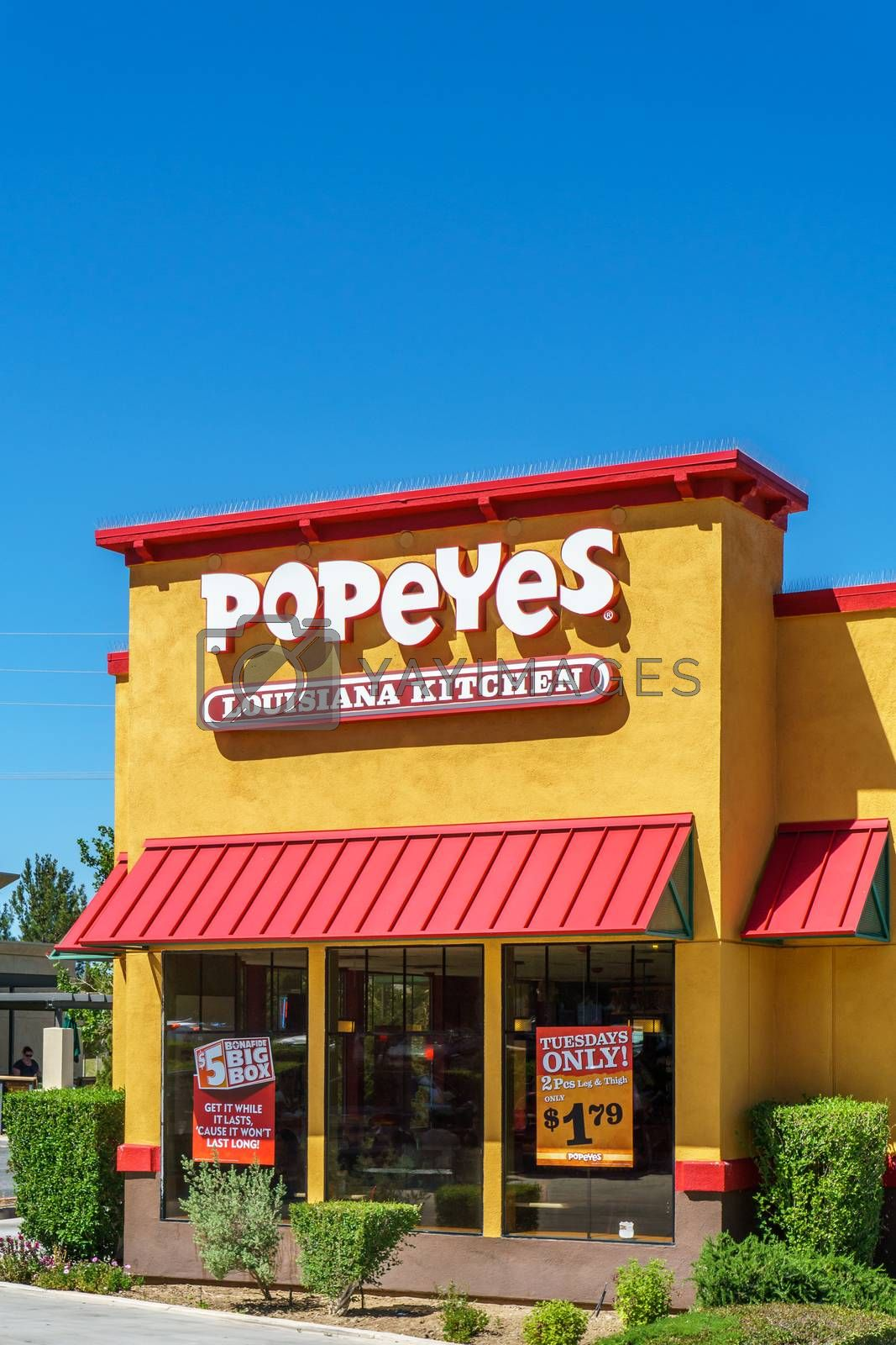 PALMDALE, CA/USA - APRIL 23, 2016: Popeyes Louisiana Kitchen exterior. Popeyes Louisiana Kitchen is an American chain of fried chicken fast food restaurants.
