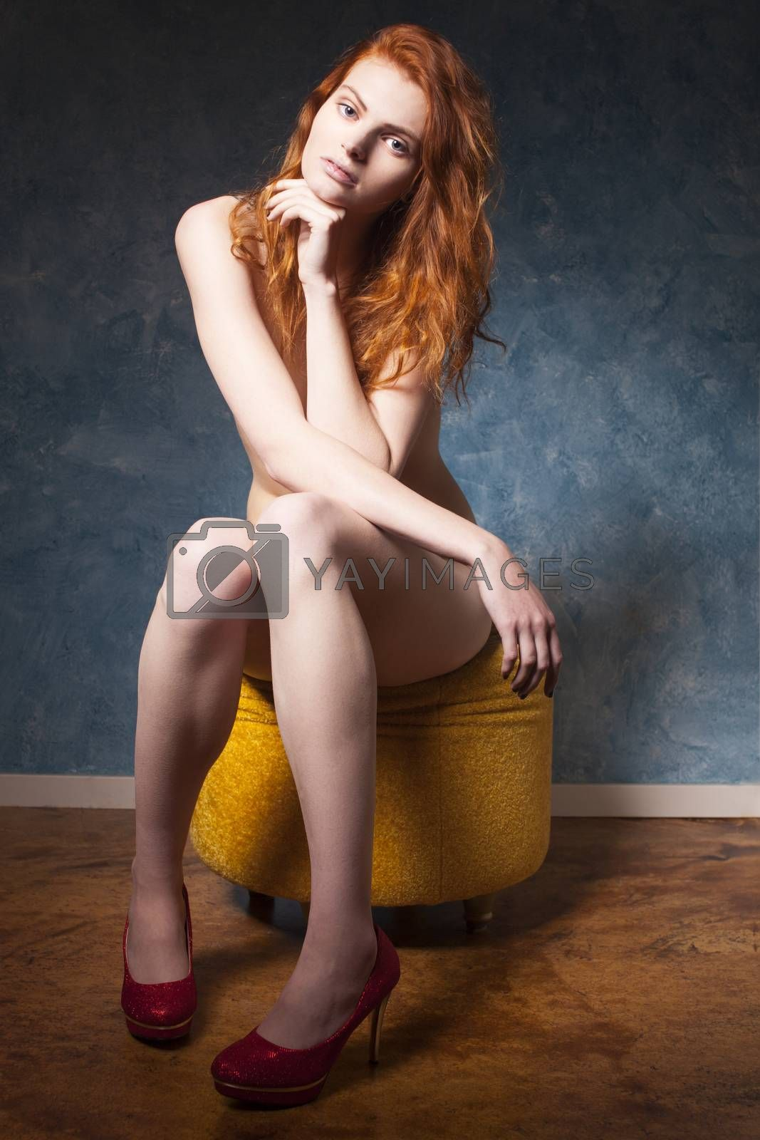 nude redhead sitting on a blue wall  by bernjuer
