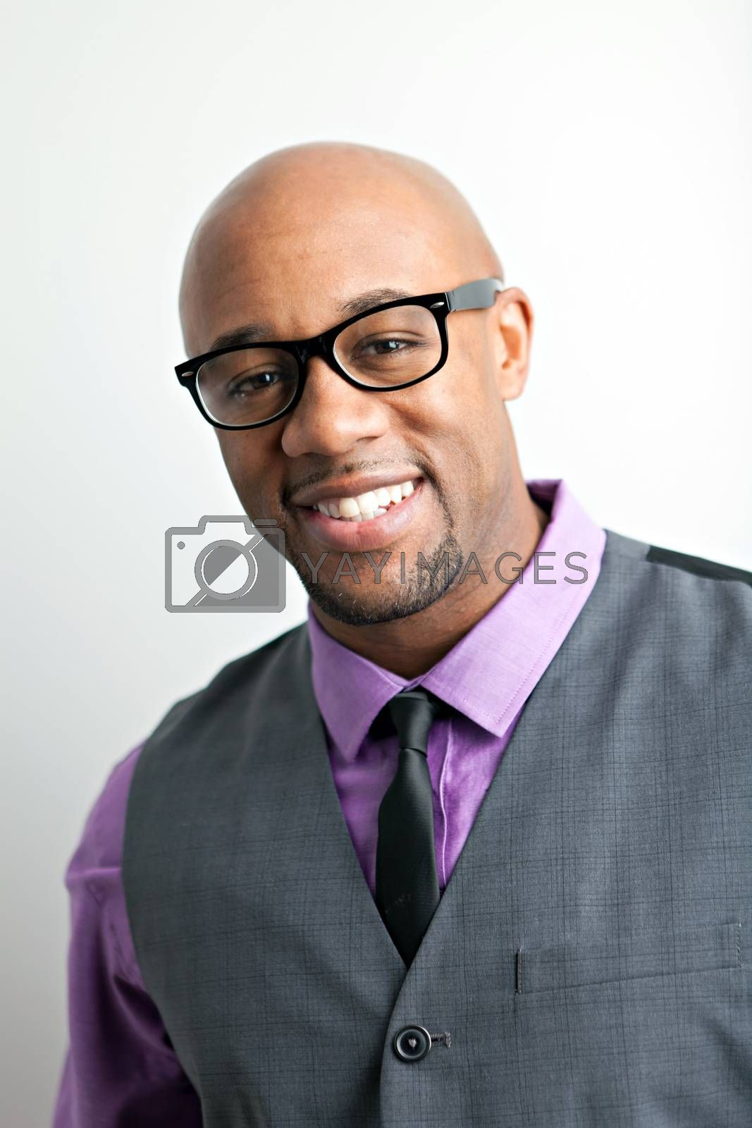 Stylish modern business man wearing black framed glasses.