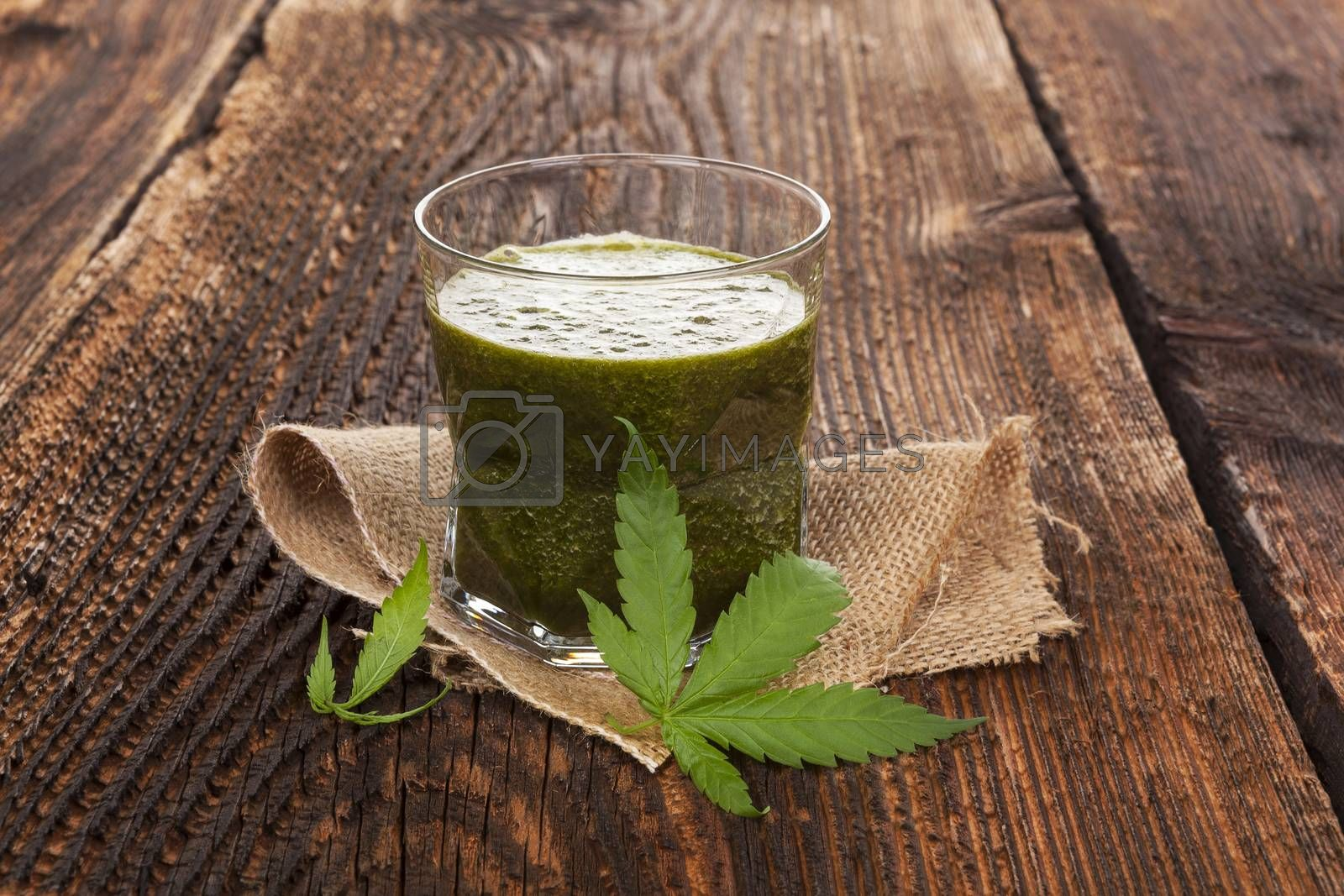 Healthy cannabis smoothie on wooden background. Natural supplement, detox and healthy living.